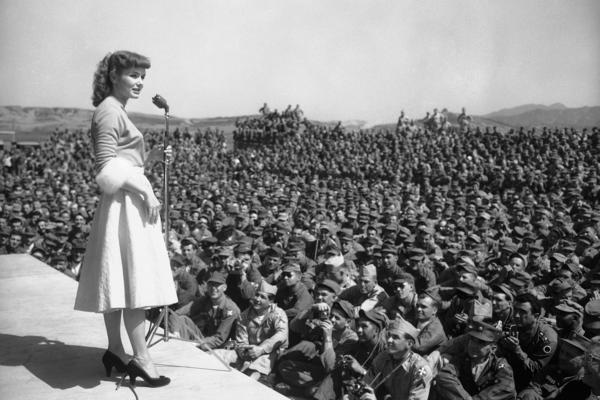 Debbie Reynolds entertains soldiers at the 8th Army headquarters in Seoul, South Korea, in 1955.