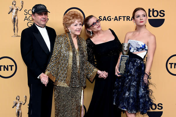 Debbie Reynolds poses for a photo with her son, Todd Fisher, daughter, Carrie Fisher, and granddaughter, Billie Lourd, after Reynolds received the Screen Actors Guild Life Achievement Award in 2015.