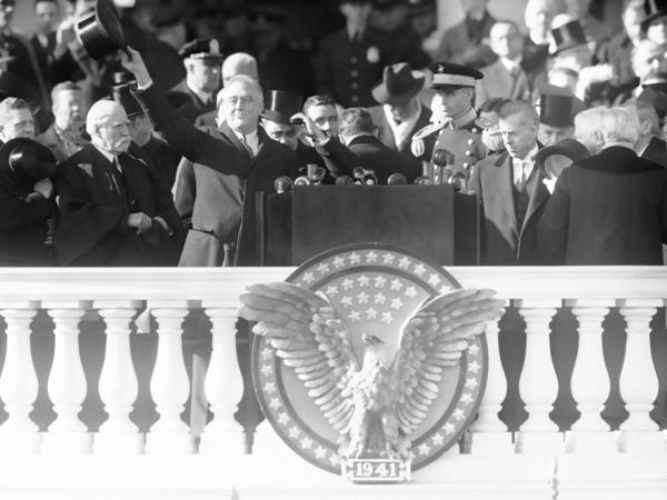 President Franklin Delano Roosevelt waves from the inaugural stand on Capitol Hill in Washington on Jan. 20, 1941.