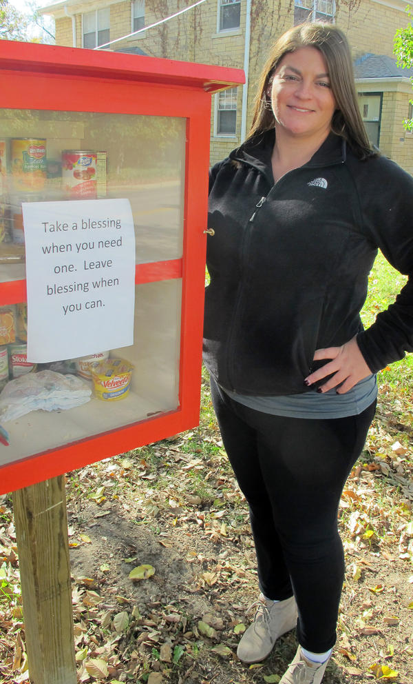 """Maggie Ballard of Wichita, Kan., and her """"blessing box"""" filled with food and personal care items that she and others have donated."""