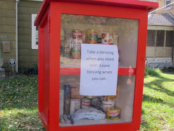 """Nonperishable food is restocked in Maggie Ballard's """"blessing box"""" in Wichita, Kan., several times a day."""