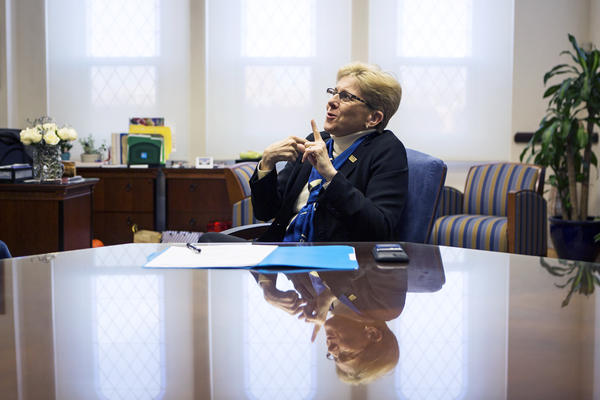 Gallaudet University President Roberta Cordano speaks using American Sign Language in her office in Washington, D.C. She is the first Deaf woman president at the university.