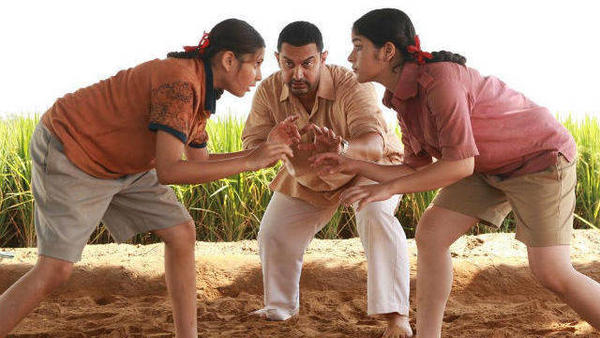 Actor Aamir Khan plays former wrestler Mahavir Singh Phogat, training his on-screen daughters in the art of wrestling, in the film <em>Dangal</em>.