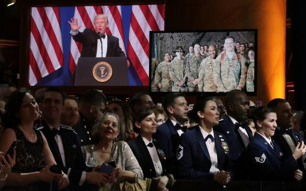 President Trump talks with service members in Bagram Airfield, Afghanistan via video link during the Salute to Our Armed Services Ball at the National Building Museum in Washington, D.C.