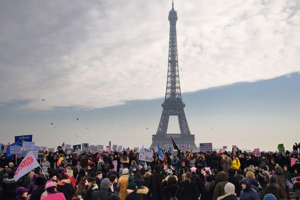 Demonstrators gather for a rally at the Place de Trocadero in Paris in solidarity with supporters of the Women's March in Washington.