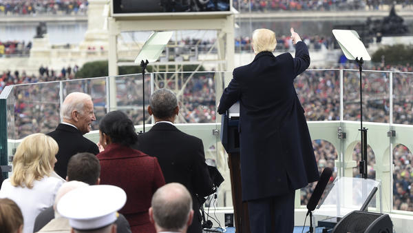 President Trump acknowledges the crowds on the National Mall during his swearing-in Friday at the U.S. Capitol in Washington, D.C.
