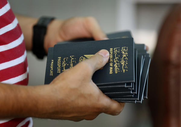 An employee delivers new passports at the main Baghdad Passport office in the Iraqi capital in 2015.