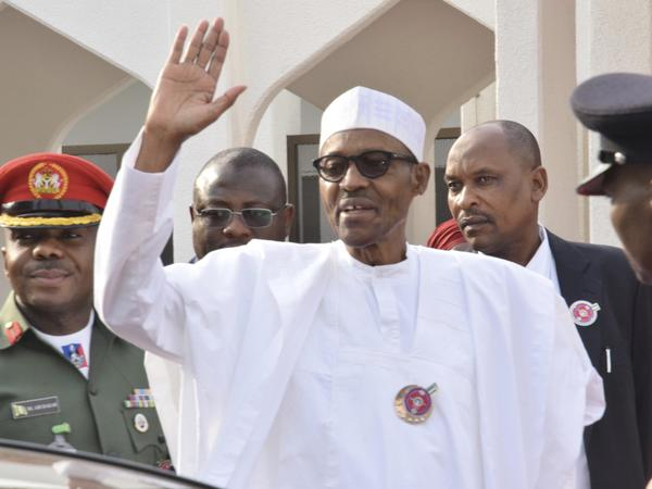 Nigeria President Muhammadu Buhari waves after a meeting in Abuja, Nigeria, on Jan. 9.
