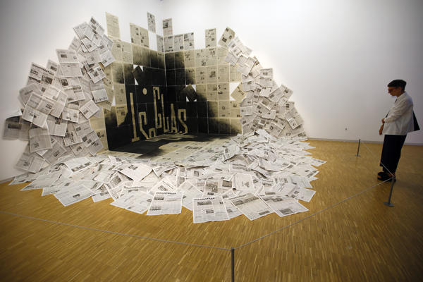 A visitor views <em>Le Coin/Glasnost 1989</em> by Dmitri Prigov at the Kollektsia Russian contemporary art exhibition at the Pompidou Center in September 2016.