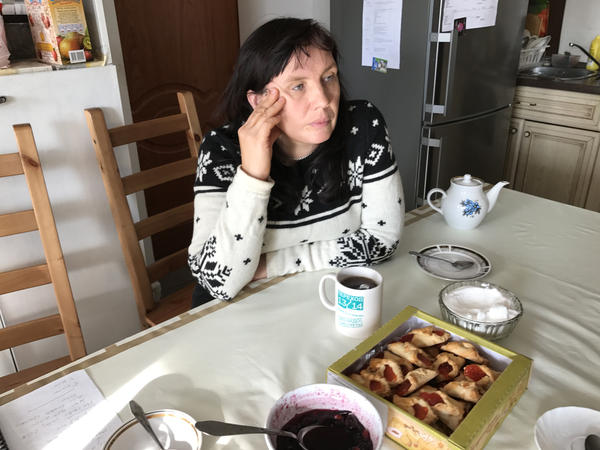 """Alyona Sadikova sits in the kitchen of the women's shelter she heads on the outskirts of Moscow. """"We try to get women back on their feet. This is not a hotel,"""" she says. """"We're not saviors; we want women to save themselves."""""""