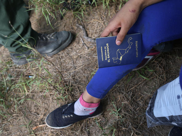An El Salvadoran child is interviewed by a U.S. Border Patrol agent after crossing the Rio Grande from Mexico into the U.S. to seek asylum on Apr. 14, 2016, in Roma, Texas.