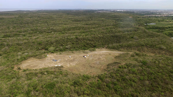 This aerial image shows the area known as Colinas de Santa Fe where Mexican authorities work to find the remains of people buried in mass graves on the outskirts of Veracruz. More than 250 skulls were found there earlier this year in what appears to be a drug cartel's mass burial ground, prosecutors said.