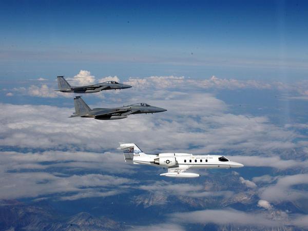 Two F-15 Eagles from Elmendorf Air Force Base, Alaska, intercept a C-21 during a homeland defense exercise in Alaska.