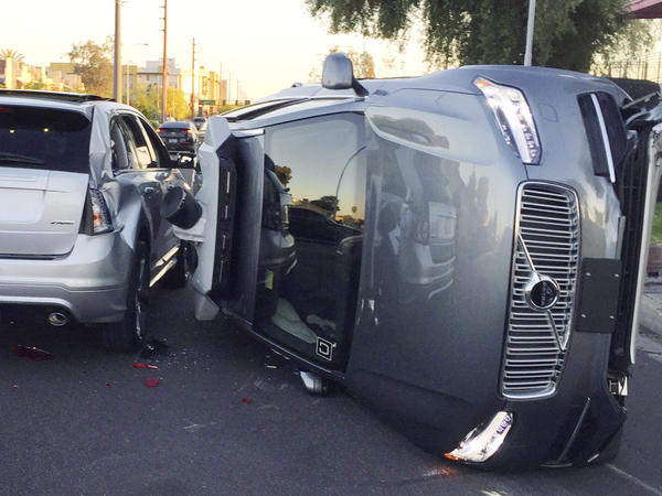 This March 24 photo provided by the Tempe, Ariz., Police Department shows an Uber self-driving SUV that flipped onto its side in a collision.