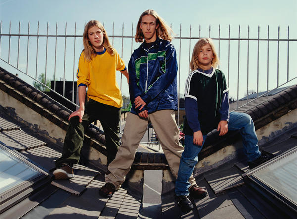 Members of the pop band Hanson pose for a group portrait on a roof in London in 1997. From left to right they are Taylor, Isaac and Zac Hanson.