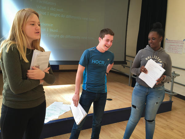 After participating in tolerance workshops for two days, Maddie Kennedy (left), Josh Gladstone and Raven Bogues practice being presenters before they run the same workshops for their peers.