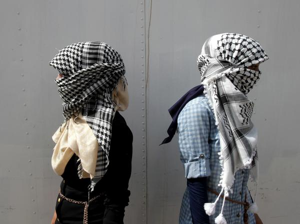 """Black-and-white keffiyeh like the one pictured above have long been associated with Yasser Arafat and the Palestinian resistance. This week, fast-fashion Brit emporium Top Shop used similar fabric for a """"scarf playsuit."""""""