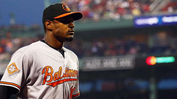 Adam Jones walks off the field during Tuesday night's game at Fenway Park.