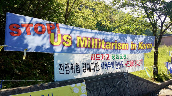 Protest banners hang in rural Seongju county, where the U.S. has installed a missile defense system known by its acronym, THAAD. Residents oppose the installation, and it's become an issue in South Korea's upcoming presidential election. The front-runner says he wants to rethink the U.S. deal.
