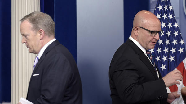 National Security Adviser H.R. McMaster, right, takes to the stage Tuesday at the White House after being introduced by Press Secretary Sean Spicer. Both of them, as well as Vice President Mike Pence, have had their credibility damaged after issuing denials that President Trump later reversed.