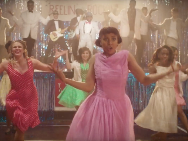 "Students dance at a high school sock hop in a scene from a video for Chuck Berry's ""Big Boys."""