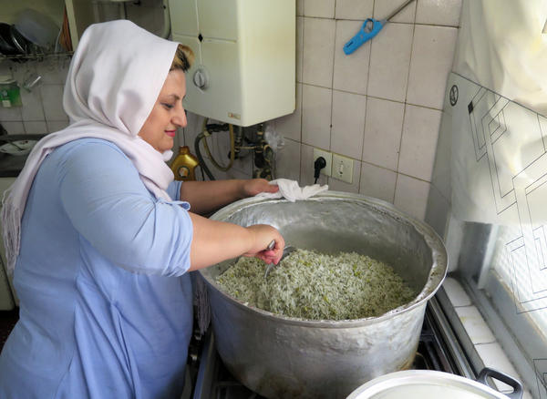 Maral Mohamedzadeh prepares food at her home for Mamanpaz, an organization that works with dozens of housewives to deliver home-cooked meals to businesses.