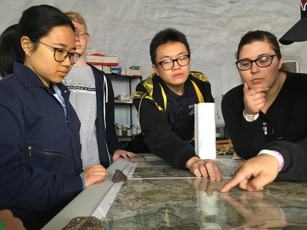 Crew members Jingjit (from left), Joseph Quaas, Caleb Li and Victoria LaBarre review the team's next excursion.