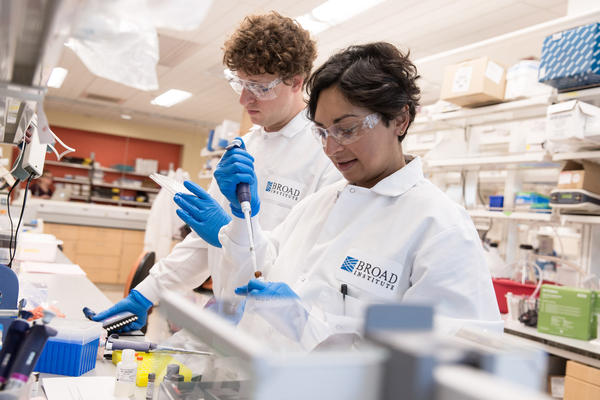 Eric and Sonia prepare materials for an experiment measuring prion protein in spinal fluid. They're both third-year Harvard graduate students doing research at the Broad Institute in Cambridge, Mass.