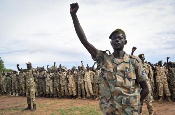 Soldiers cheer at a ceremony marking the 34th anniversary of the Sudan People's Liberation Army, attended by President Salva Kiir, in Juba on May 18.