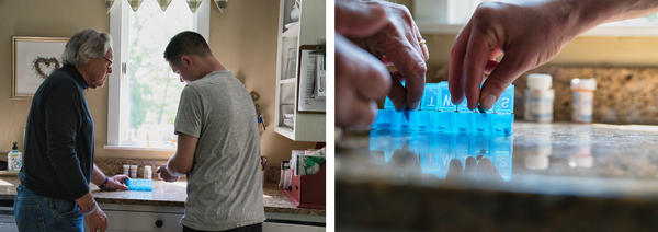Greg's son Conor helps his dad organize medications. Greg takes multiple drugs to treat the symptoms of Alzheimer's.