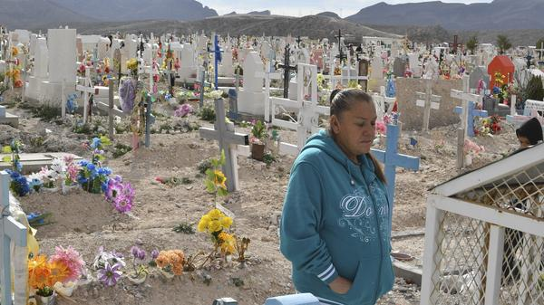 Maria Guereca visiting the grave of her murdered son Sergio Hernandez in February.