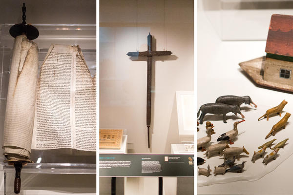 A plethora of religious iconography fill the National Museum of American History's new exhibit, <em>Religion in Early America</em>. From left to right, an 18th century Torah scroll, a 17th century Catholic cross and a children's Noah's Ark playset from 1828 sit on display.