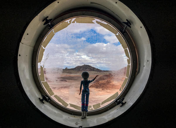 "An astronaut Barbie waves from the habitat's porthole. LaBarre ""rescued"" the doll in a test of the crew's prototype emergency rover."
