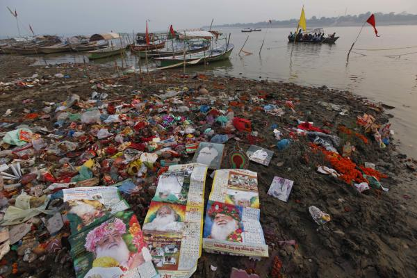 The flotsam of flowers, earthenware, religious idols and clothing left behind by pilgrims clog the banks of the Ganges in Allahabad, India. But the biggest polluter is millions of gallons of untreated sewage discharged into the river.
