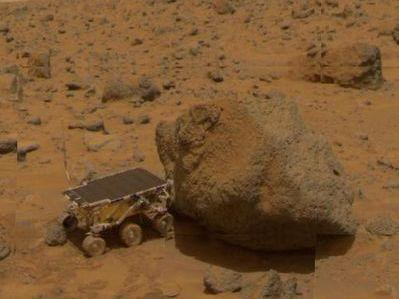 """Close-up of the rover Sojourner taken by NASA's Mars Pathfinder next to a rock called """"Yogi."""""""
