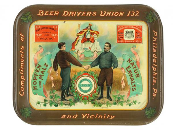 """This beer tray, circa 1905 — from the Beer Drivers Union 132 — shows a driver and a brewer working together. It says in German """"Liberty, Equality, Fraternity."""""""
