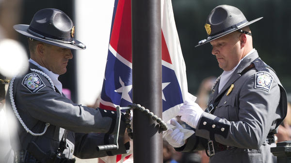 An honor guard from the South Carolina Highway Patrol lowers the Confederate battle flag on the grounds of the South Carolina Statehouse on July 10, 2015.