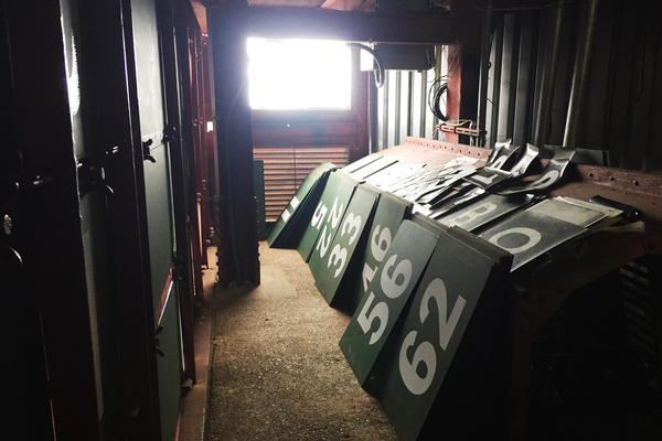 Spare numbered steel panels are stored along the catwalk inside the scoreboard until they are needed to be inserted into an inning.
