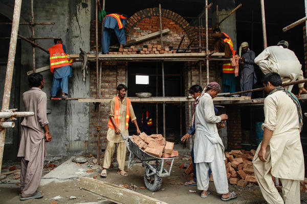 Laborers work to prepare the new Pakistan history museum in Lahore's Greater Iqbal Park. The museum — a project of the provincial government and the private Citizens Archive of Pakistan — will be the first to look at Partition through the stories of those who witnessed it.