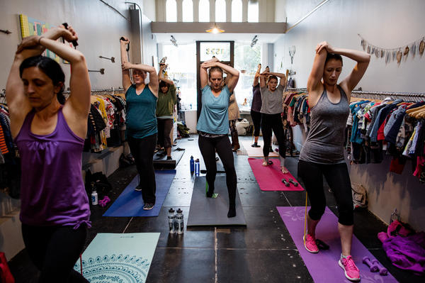 Students are taught a number of exercises in Keller's class aimed at new moms in San Francisco, Calif.
