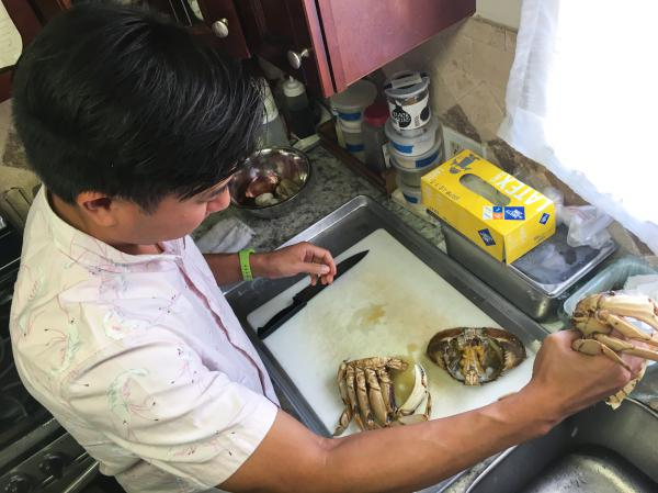 Nguyen Tran prepares the crab and removes the claws to make his signature dish – the Singaporean chili crab.