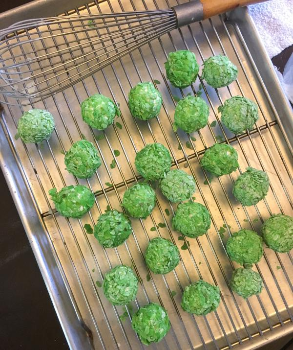 The tofu balls are dipped into a flour and water mix and then coated with crispy green rice.
