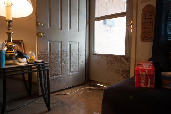 Flood levels are marked in dirt on the front door of Emma Dunn's home in the Kashmere Gardens neighborhood of Houston.