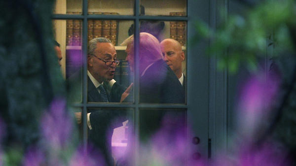 Democratic Senate Minority Leader Chuck Schumer of New York and President Trump embrace in the Oval Office after a meeting at which Trump agreed with Democrats, casting aside Republicans.