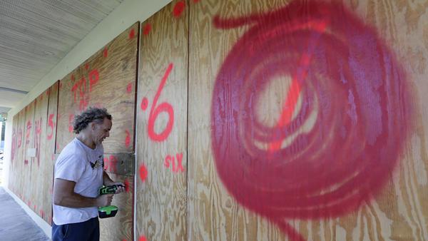 Erik Budman hangs plywood at a Key Largo, Fla., business in preparation for Hurricane Irma.
