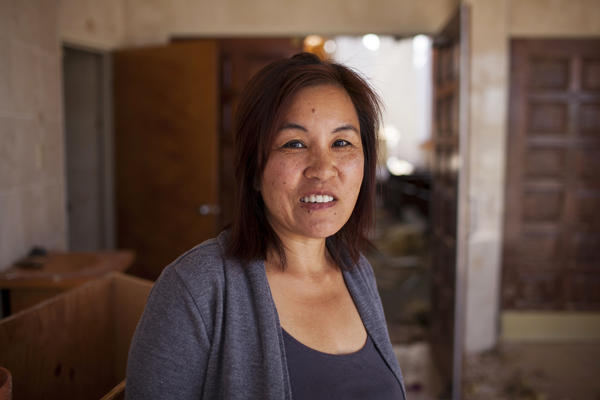 "Leah Oliva is Father Tran's assistant. ""I helped to start the Sunday school program. Now there is no place for Sunday school,"" Oliva says. ""The challenge will be how we are going to rebuild the church. It is important that we hold services here this Sunday, so that [Father Tran] can start communicating with the congregation."""