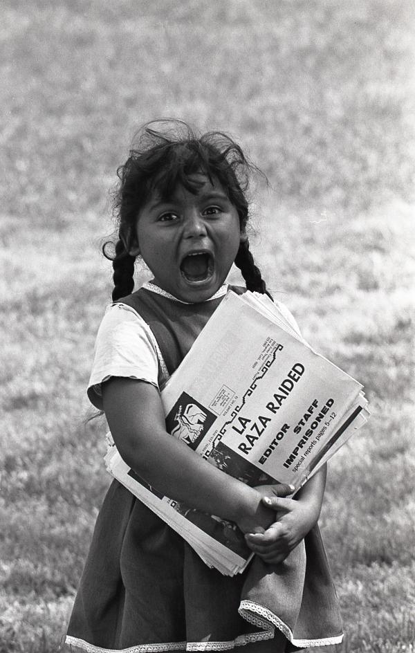 <em>A young Chicanita hawks </em>La Raza<em> newspapers at the Poor People's Campaign, Washington, D.C.</em> May–July 1968.