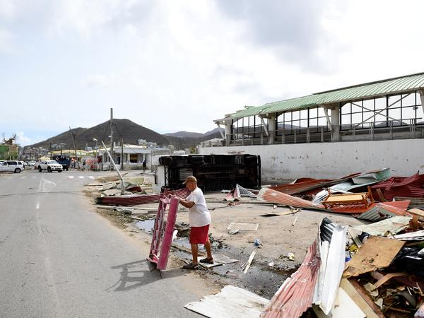An overturned truck and other debris from Hurricane Irma are seen on St. Martin on Friday. The Caribbean island is one of those in danger of taking a second battering, from Hurricane Jose.