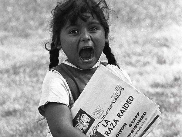 <em>A young Chicanita hawks </em>La Raza<em> newspapers at the Poor People's Campaign, Washington, D.C.</em> <em>May-July 1968.</em>