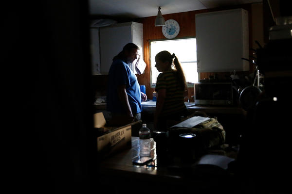 Nancy and Christian Schneider live in the Holly Lake Mobile Home park, where they haven't had electricity in their home since Hurricane Irma struck Florida over a week ago.